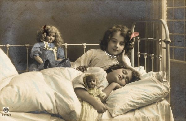 Two sisters prepare for bed - and of course their dolls come to bed with them