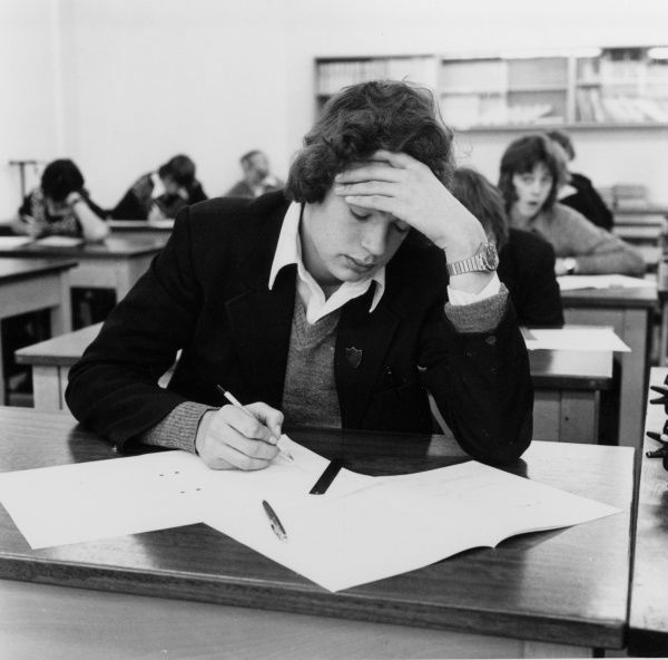 Pupils sitting an exam at Manor School, Stroud, Gloucestershire, England. Date: 1975