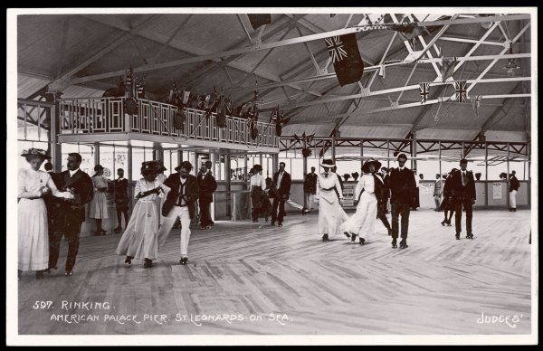 Elegant men and women skate on a rink at the American Palace Pier, St Leonards-on-sea
