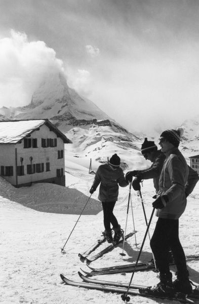 Skiers on the slopes above Zermatt, Switzerland. Date: 1960s