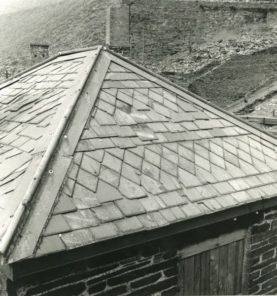 Intricate patterning made from slate on the roof of an abandoned weighbridge building at Blaenau Ffestiniog Slate Quarry, Caernarvonshire (now Gwynedd), North Wales