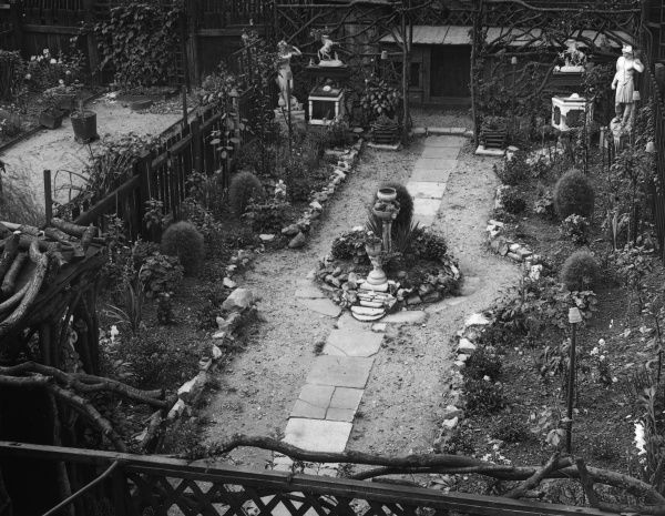 Even a small cottage garden. although limited in regard to space, can be made extremely picturesque. This example is in suburban London. Date: 1930s