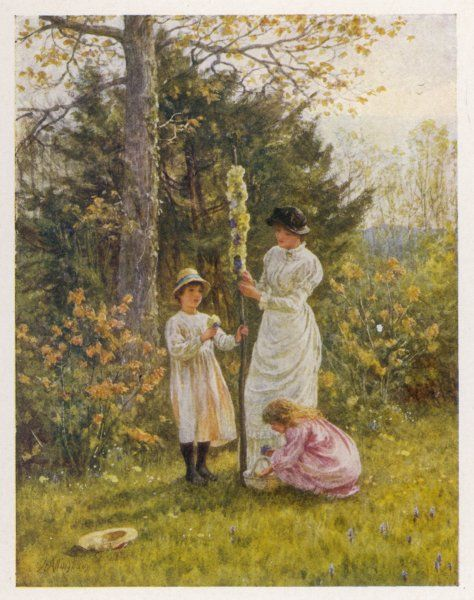 A mother helps her children deck a small, domestic maypole