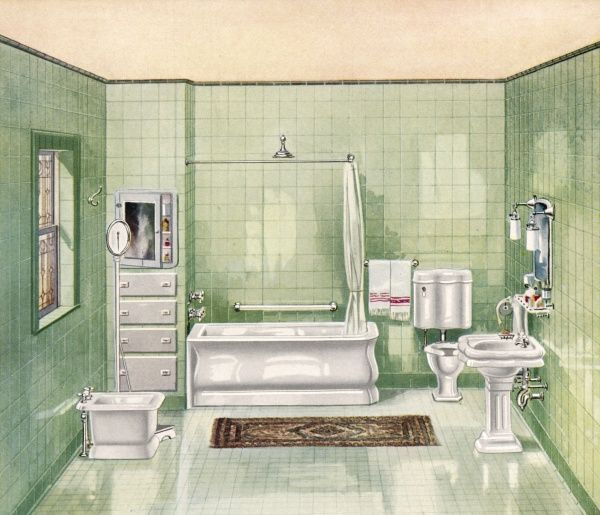 A state-of-the-art bathroom, fully tiled, with lavatory, bath, shower head, bidet and wash basin