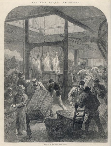 The arrival of an early meat train at Smithfield Market in London: porters unload and move baskets and crates