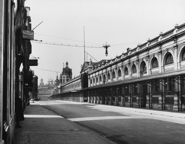 A fine view of the exterior of Smithfield Market, City of London, on a summer's day, only two months before the outbreak of World War Two