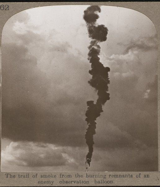 The trail of smoke from the burning remnants of a German observation balloon