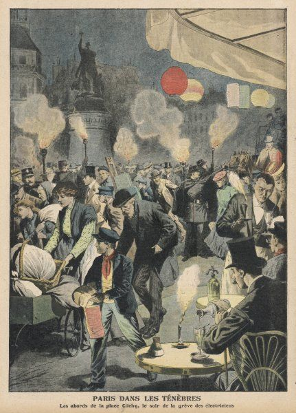 During the electricians' strike, Parisians in La Place Clichy drink by candlelight