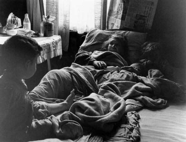A family in a slum house in Liverpool Date: 1960
