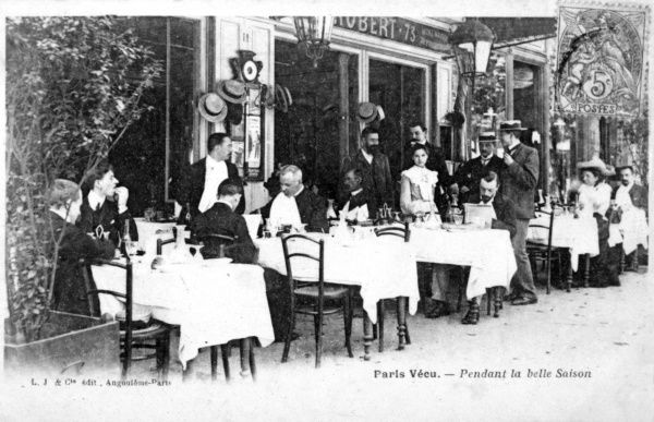 People at tables on the terrace of a cafe in Paris at the height of the season Date: 1906