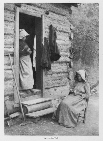 Two mountain women of North Carolina at the doorway of a log cabin Date: 1903
