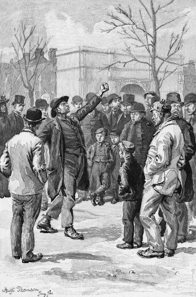 A Socialist orator at 'Speakers' Corner' in London's Hyde Park, near the Marble Arch, attracts an audience of working men, while a gentleman in a top hat passes by Date: 1892
