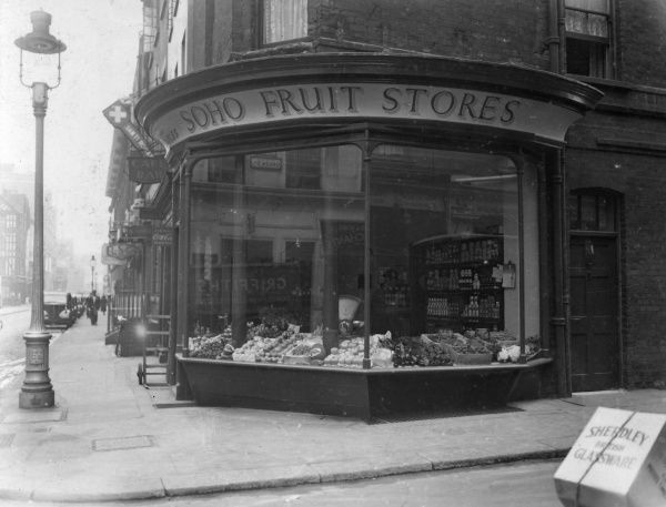 A corner greengrocers shop in Soho, central London with an impressive bow window. 1940s