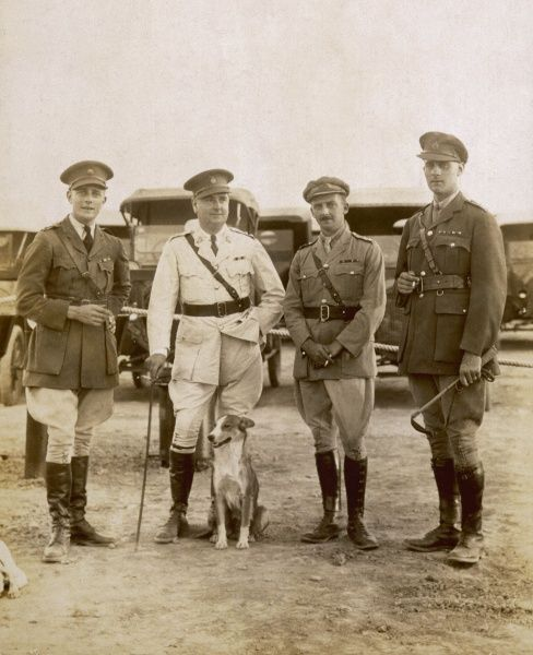 Four soldiers and a dog