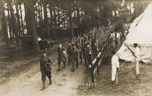 An officer leads a detachment of the Officers Training Corps, Mytchett, at the camp at Camberley, Surrey