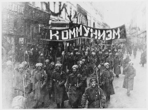 Soldiers march through the streets of Moscow with a banner bearing a single word : 'COMMUNISM&#39