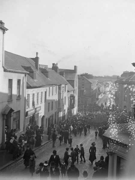 Soldiers parade up the High Street in Haverfordwest, Pembrokeshire, Dyfed, South Wales, watched by various townspeople, around the time of the outbreak of the First World War