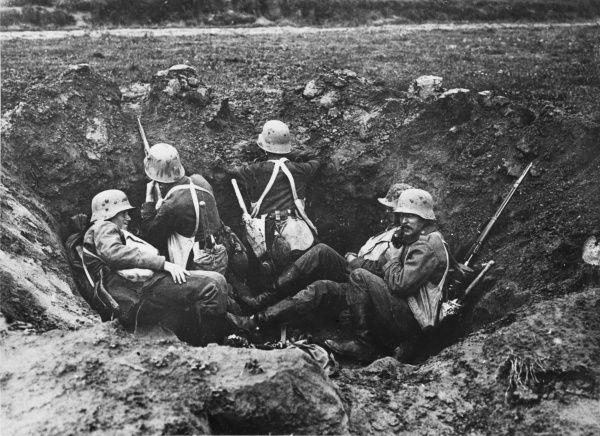 Soldiers sheltering in a grenade pit in Flanders during World War I