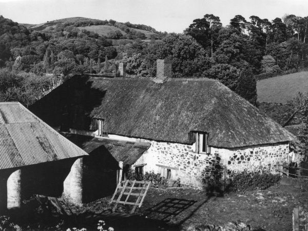 Lawford Farm, a charming thatched farmhouse, standing amidst the hills of the Lower Quantocks, at Crowcombe, Somerset, England. Date: 1930s