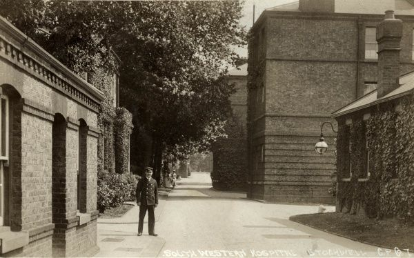 A porter at the entrance to the South Western Fever Hospital, opened in 1871 on Landor Road, Stockwell, South London