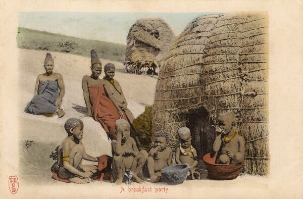 Native Village in Southern Africa. The children eat breakfast. Date: 1904