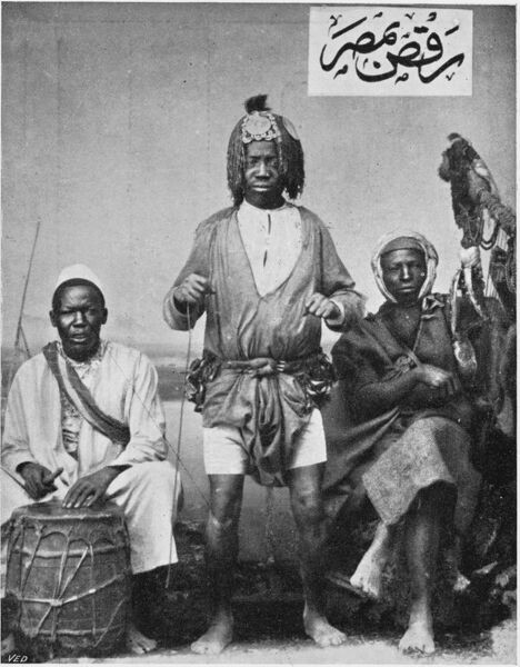 The 'Eccentric' dancers of Southern Egypt (modern Sudan), complete with drummer and elaborate headresses