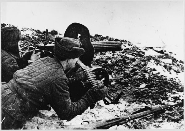 Soviet machine gun crew with a 7-62 Maxim machine gun