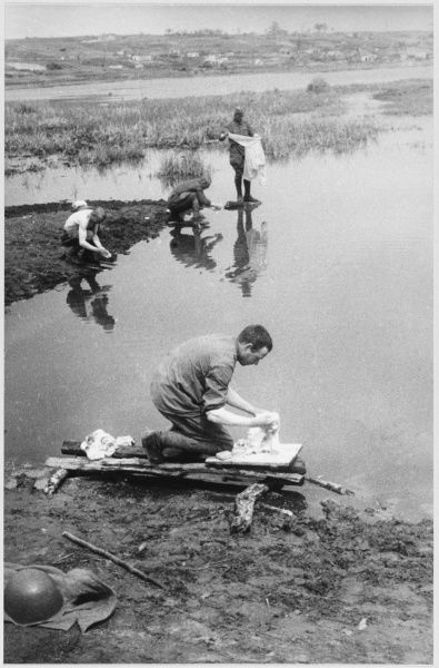 Soviet soldiers wash their clothing in the Ukraine. Date: 1942 - 1945