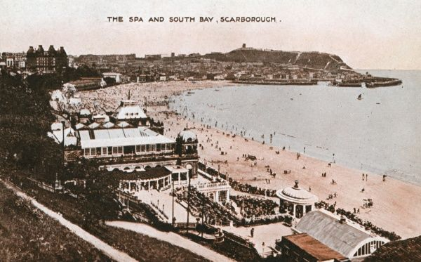 The Spa and South Bay, with a view of the beach, the harbour, and the castle on a distant cliff, at Scarborough, North Yorkshire. The four turrets of the Grand Hotel can be seen on the left horizon. Date: 1920s