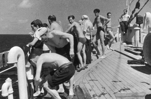 Mexico-bound refugees sunbathing during voyage to Mexico during World War II