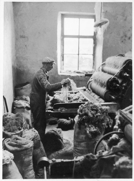 Production of Harris Tweed. The wool is carded and spun; carding loosens the wool and ensure it is fine enough to spin