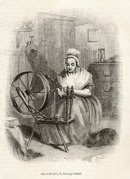 A woman spins wool on a 'Saxony' type of spinning wheel