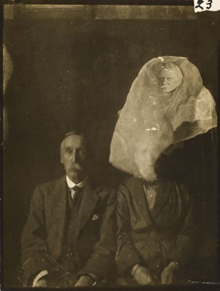 Unattributed spirit photograph but probably by medium, Ada Dean. Sitters Mr Rist and wife? with an unidentified male spirit hovering above them both