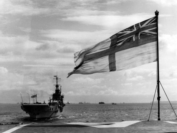 Afloat with the British Royal Navy: A view of the White Ensign (flag) at Spithead, of the Isle of Wight, England. Date: 1930s