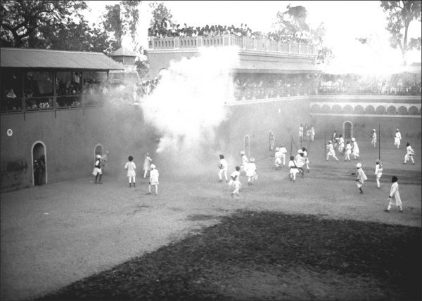Smoke is pumped into a sporting arena in India, possibly to further agitate fighting animals, here obscured beneath the white cloud