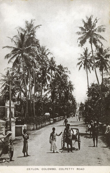 Sri Lanka - Colpetty Road, Colombo - Rickshaw drivers and tall palm trees. Date: 1927