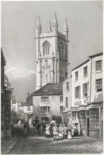 Street scene in Saint Austell, Cornwall, with the church tower rising above the other buildings