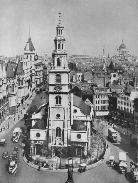 Imposing view of St. Clement Danes with The Royal Corts of Justice to the left and St. Paul's Cathedral in the distance