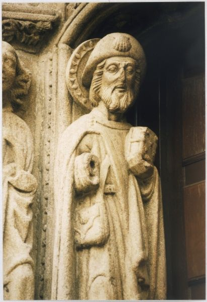 SANTIAGO (St James) DI COMPOSTELLA - figure in a doorway at the cathedral, depicting him as a pilgrim with the traditional 'coquille saint Jacques' emblem