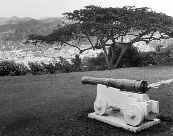 A cannon on the lawn of Government House, overlooking Castries, St. Lucia, West Indies. Date: 1960s