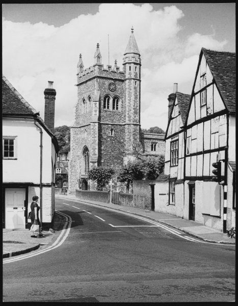 The fine old church of St. Mary, Amersham, Buckinghamshire, England, with some of the picturesque old houses in this town of ancient buildings