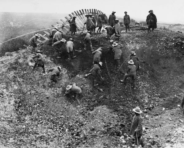 Soldiers working on the embankment of the St. Quentin-Busigny Line crater on the Western Front in France during World War I in October 1918