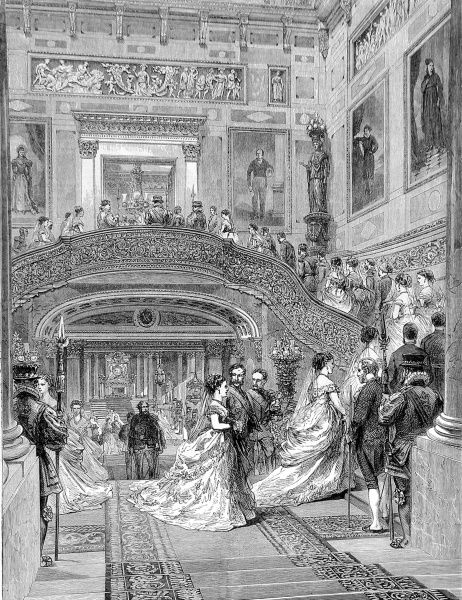 Engraving showing a large group of people in formal evening dress ascending the staircase at Buckingham Palace, London, 1870