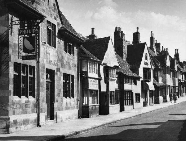 Beautifully preserved stone houses and shops on Stamford High Street, Lincolnshire, built in the 18th and 19th centuries when travellers came on the Great North Road