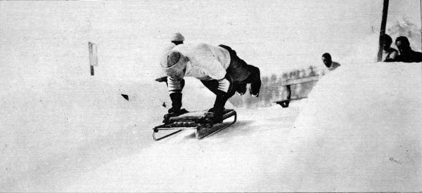 Photograph showing a member of the St. Moritz Tobogganing Club leaping onto his machine at the top of the Cresta Run, 1912. This famous course was first laid out in 1884