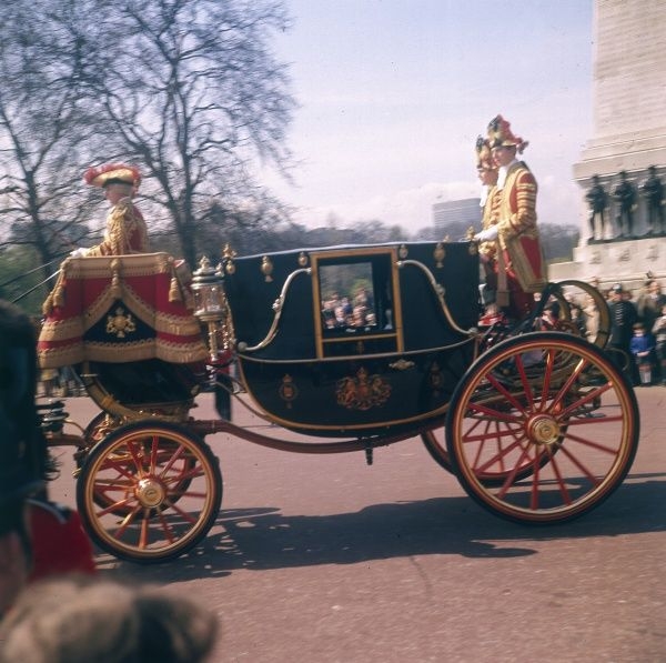 Queen Elizabeth II travelling to the State Opening of Parliament in the Royal Coach, London, England. Date: 1966