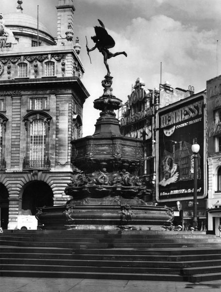 The famous statue of the Greek god of love, Eros, Piccadilly Circus, London, was sculpted by Alfred Gilbert in 1893. It was originally called the Shaftesbury Monument. Date: 1893