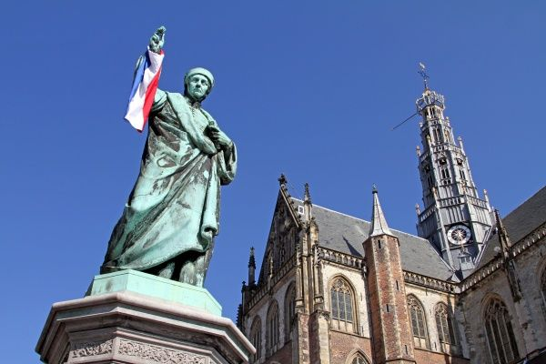 Statue of Laurens Janszoon Coster and the Grote Kerk or St. Balo Church in Haarlem, Holland circa 2008