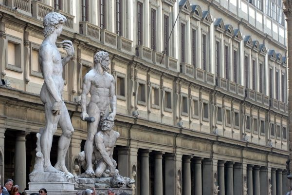 Replica of Michaelangelo's statue of David and statue of Hercules and Caco in front of the Uffizi Gallery, Florence, Italy