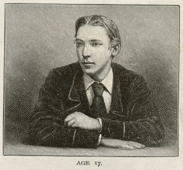 ROBERT LOUIS STEVENSON The Scottish writer and poet at the age of 17, arms folded on his desk